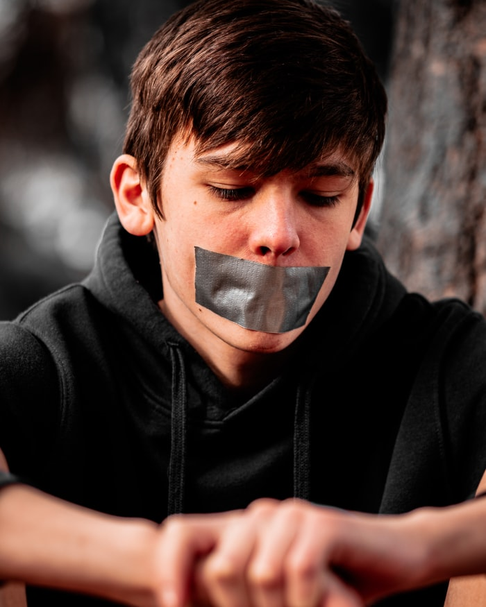Voluntarily silenced, subject to the fear of exclusion or punishment for speaking my truth